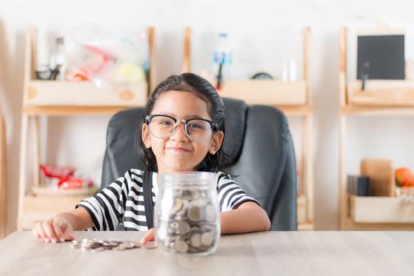 Child with money jar
